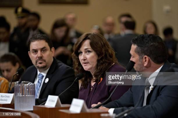 Christine Hunschofsky, mayor of Parkland, Florida, center, speaks during a Gun Violence Task Force forum in Washington, D.C., U.S., on Tuesday, Sept....