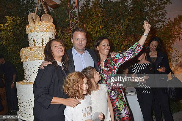 Christine Innamorato Christopher Descours Sabine Brunner from Bonpoint and kids attend the 'Bonpoint Cocktail' at L'Orangerie du Jardin du Luxembourg...