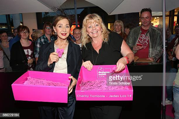 Christine Kaufmann and Inger Nilsson during the late night shopping at Designer Outlet Soltau on August 5 2016 in Soltau Germany