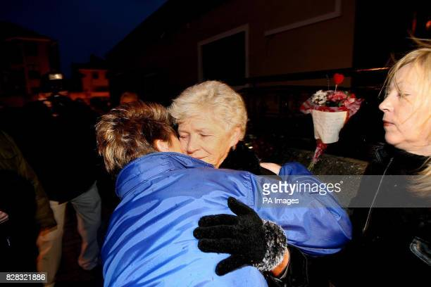 Christine Keegan who lost two daughters in the Stardust fire is comforted by relatives of victims and survivors of the Stardust fire 25 years ago who...