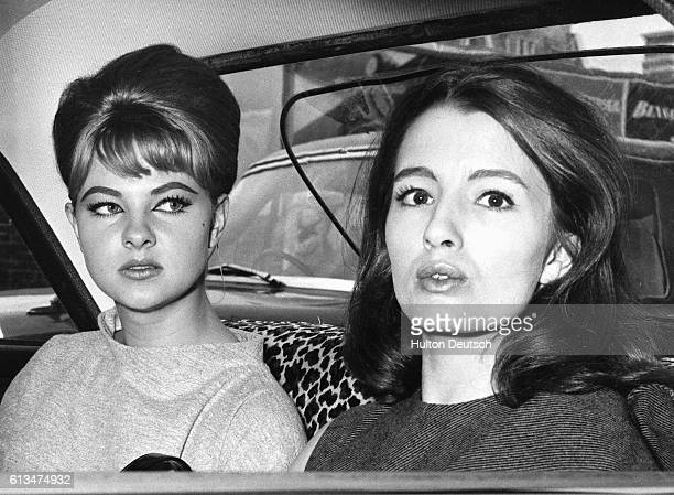 Christine Keeler and Mandy Rice Davies leave the Old Bailey after the first day of the Ward Trail concerning the Profumo scandal