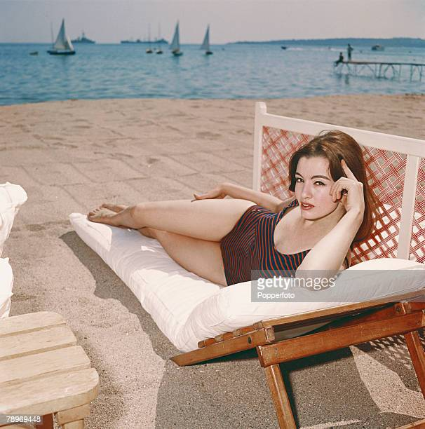 Christine Keeler key figure in the 1963 Profumo Scandal which rocked the government wearing a swimsuit as she relaxes on a sun lounger 1963