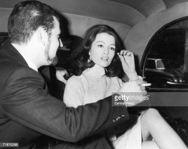 Christine Keeler leaves her flat in Devonshire Street London with her racing driver friend Paul Mann for Marylebone Court where she is expected to...