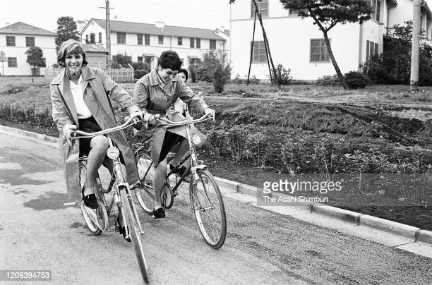 Christine 'Kiki' Caron and Monique Pietri of France are seen on bicycles at the Athletes' Village ahead of the Tokyo Olympic Games at the Athletes'...