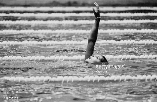 Christine Kiki Caron of France competes in heat number four of the Women's 100 metres Backstroke on 13th October 1964 during the XVIII Summer Olympic...