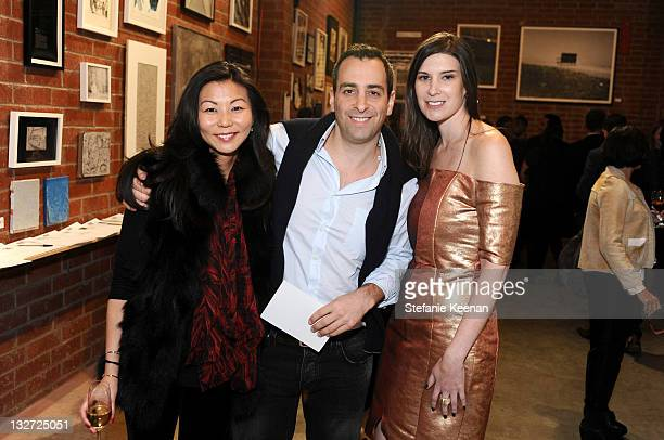 Christine Kim Sammie Heller and Sima Familant attend LAXART Benefit Auction And Party on November 13 2011 in Culver City California
