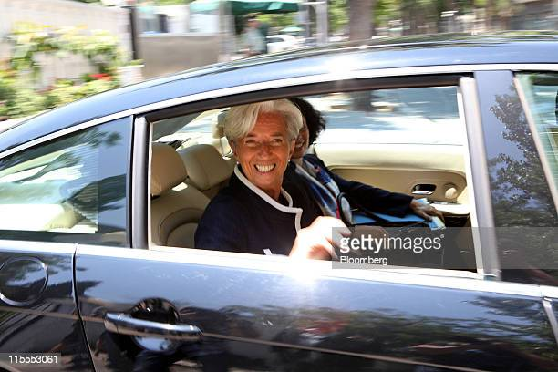 Christine Lagarde France's finance minister reacts as she leaves the French Ambassador's residence in Beijing China on Wednesday June 8 2011 Lagarde...