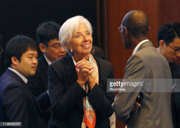 Christine Lagarde managing director of the International Monetary Fund reacts as she speaks with an attendee during the Group of 20 finance ministers...