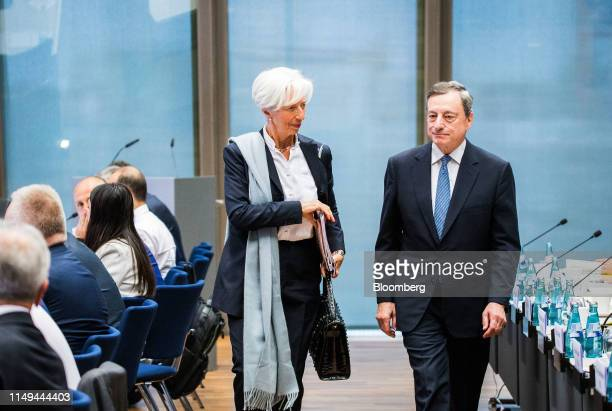 Christine Lagarde managing director of the International Monetary Fund left arrives with Mario Draghi president of the European Central Bank at the...