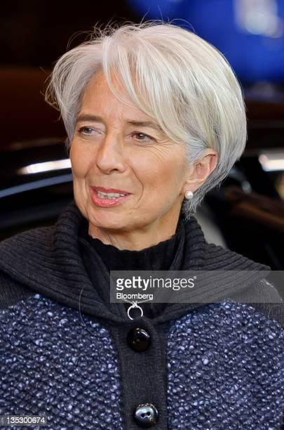 Christine Lagarde managing director of the International Monetary Fund arrives to attend a working dinner as part of a twoday summit of European...