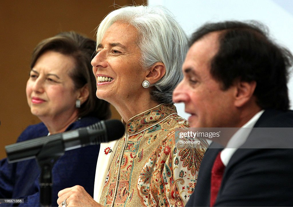 Christine Lagarde, managing director of the International Monetary Fund (IMF), sits with Zeti Akhtar Aziz, governor of Bank Negara Malaysia, left, and Anoop Singh, director for the Asia and Pacific Department of the International Monetary Fund (IMF), right, ahead of a news conference in Kuala Lumpur, Malaysia, on Wednesday, Nov. 14, 2012. Lagarde today kicked off a three-country tour of Southeast Asia, which is thriving after emerging from turmoil more than a decade ago. Photographer: Goh Seng Chong/Bloomberg via Getty Images