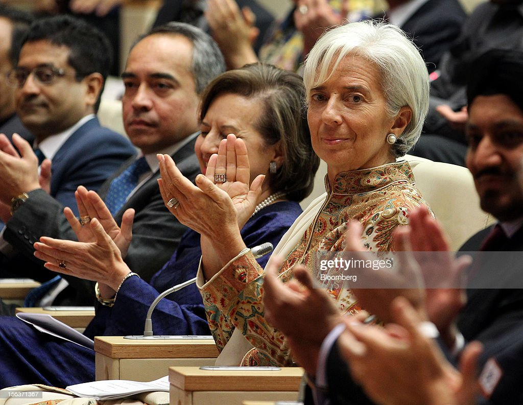 Christine Lagarde, managing director of the International Monetary Fund (IMF), center right, sits with Zeti Akhtar Aziz, governor of Bank Negara Malaysia, center left, as they applaud the speaker during a conference in Kuala Lumpur, Malaysia, on Wednesday, Nov. 14, 2012. Lagarde today kicked off a three-country tour of Southeast Asia, which is thriving after emerging from turmoil more than a decade ago. Photographer: Goh Seng Chong/Bloomberg via Getty Images
