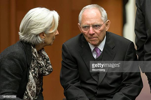 Christine Lagarde managing director of the International Monetary Fund left and Wolfgang Schaeuble Germany's finance minister speak ahead of the...