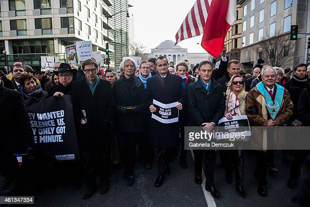 Christine Lagarde Managing Director of the International Monetary Fund left and Gerad Araud Ambassador of France to the United States right march...