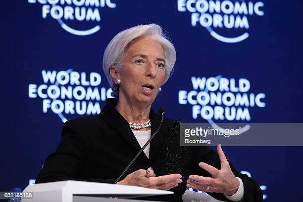 Christine Lagarde managing director of the International Monetary Fund gestures as she speaks during a plenary session at the World Economic Forum in...