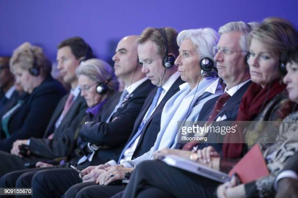Christine Lagarde managing director of the International Monetary Fund third right listens from the audience during a plenary session on the opening...
