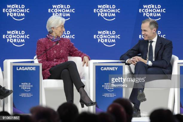 Christine Lagarde managing director of the International Monetary Fund left and Mark Carney governor of the Bank of England attend a panel session on...