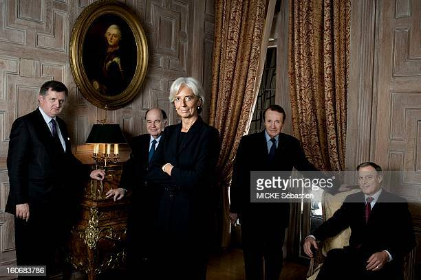 Christine Lagarde posing in a living room of the residence of the ambassador of France WASHINGTON surrounded by the central bankers present French...