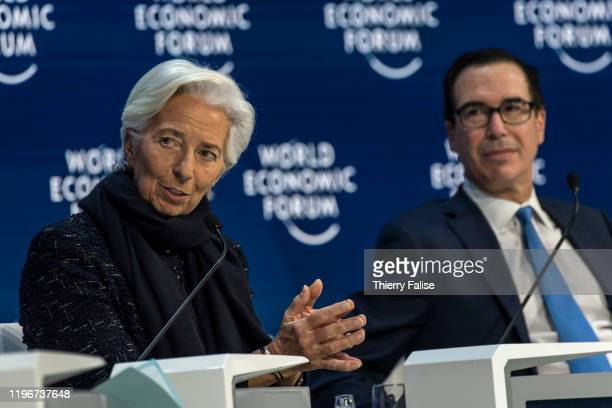 Christine Lagarde president of the European Central Bank addresses a panel during the World Economic Forum in Davos On the right sits Steven Mnuchin...