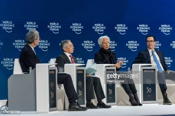 Christine Lagarde president of the European Central Bank addresses a panel during the World Economic Forum in Davos On left sits Haruhiko Kuroda...