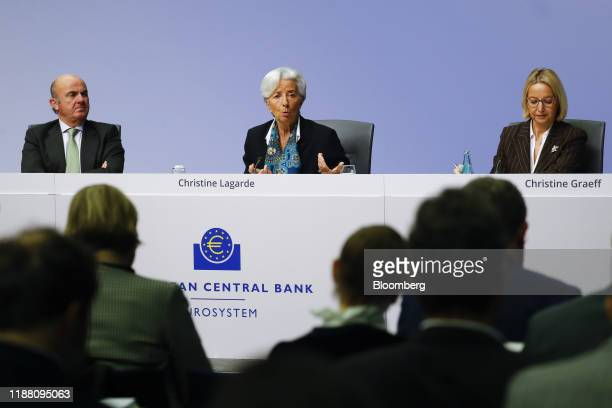 Christine Lagarde president of the European Central Bank center speaks flanked by Luis de Guindos vice president of the European Central Bank left...