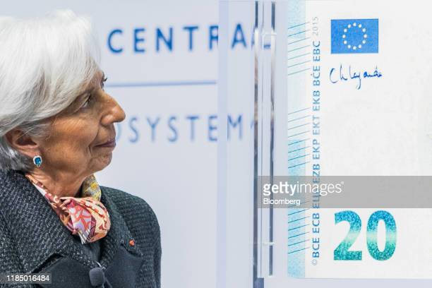 Christine Lagarde president of the European Central Bank inspects her signature after signing a 20 euro display banknote at the ECB headquarters in...