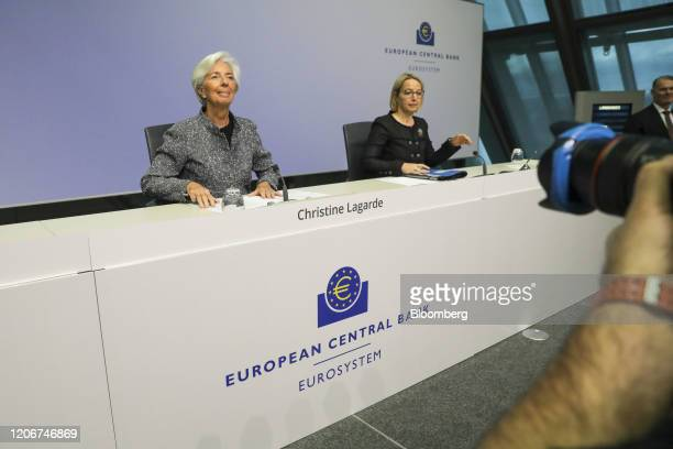 Christine Lagarde president of the European Central Bank left takes her seat beside Christine Graeff director general for communications at the...