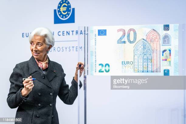 Christine Lagarde president of the European Central Bank prepares to write her signature onto a 20 euro display banknote at the ECB headquarters in...