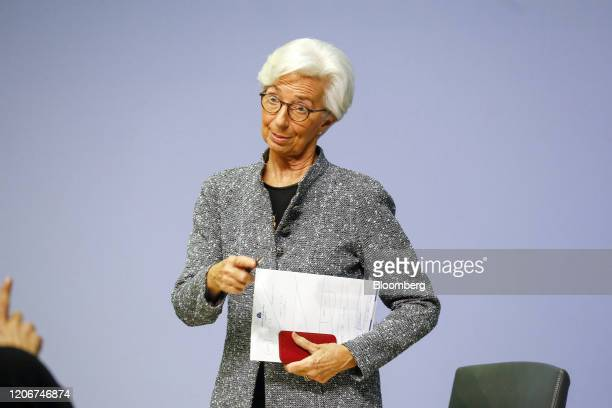 Christine Lagarde president of the European Central Bank speaks to a journalist as she departs the central bank's rate decision news conference in...