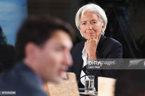 Christine Lagarde watches Canadian Prime Minister Justin Trudeau as he makes the opening remarks during the G7 Outreach working session on day two of...
