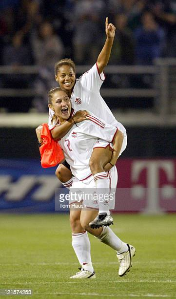 Christine Latham of Canada celebrates Canada's win with teammate Sharolta Nonen after pulling off a 10 win over Chinain The 2003 Women's World Cup...