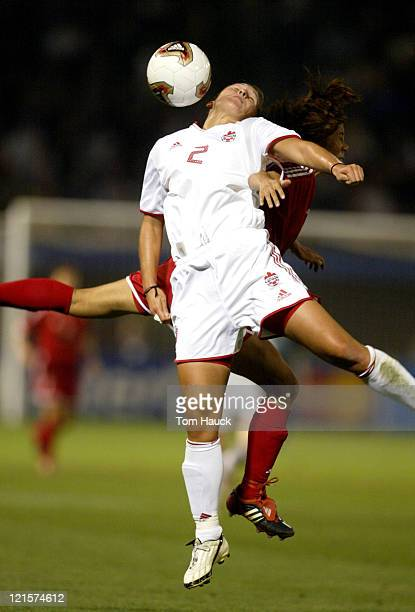 Christine Latham of Canada fights for the ball with a China defender during game action at PGE Park in Portland Oregon October 2 2003 Canada defeated...