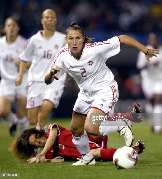 Christine Latham of Canada fights knocks down Fan Yunjie of China while fighting for the ball during game action at PGE Park in Portland Oregon...