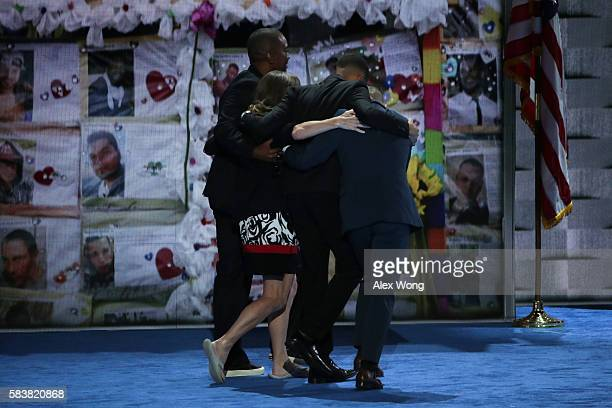Christine Leinonen mother of Christopher 'Dru' Leinonen is comforted by Brandon Wolf and Jose Arriagada survivors of the attack at the Pulse...