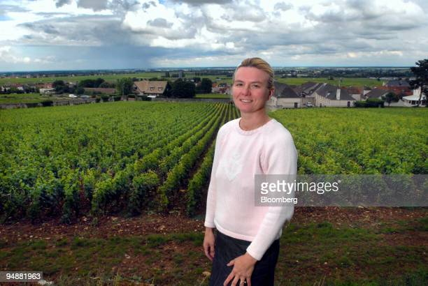 Christine Lestime, owner of the Clos Saint-Jean vineyard poses in front of her property in the Burgundy village Chassagne-Montrachet, France, on...