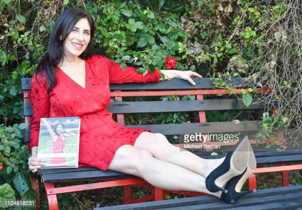 Christine Lusita poses with her book The Right Fit Formula at TAP Giveback Day on January 24 2019 in Los Angeles California