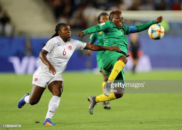 Christine Manie of Cameroon is challenged by Deanne Rose of Canada during the 2019 FIFA Women's World Cup France group E match between Canada and...