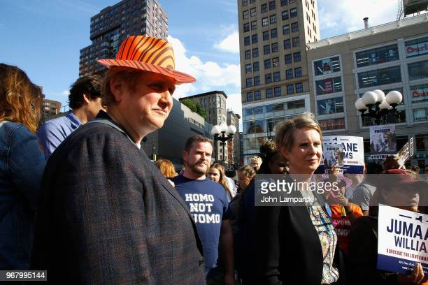 Christine Marinoni and Cynthia Nixon greet New Yorkers during the petitioning parade for New York State Governor at Union Square Park on June 5 2018...