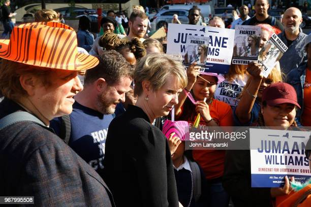 Christine Marinoni and Cynthia Nixon greet New Yorkers during the petitioning parade for New York State Governor at Union Square Park on June 5, 2018...