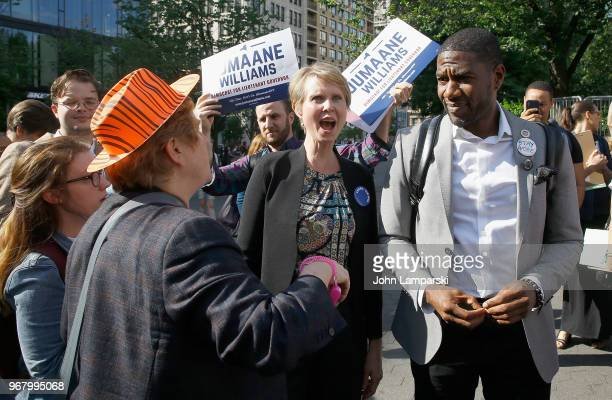 Christine Marinoni Cynthia Nixon and Jumaane Williams pause during the petitioning parade for New York State Governor at Union Square Park on June 5...