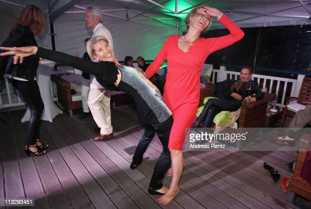 Christine Mayn and Suzanne von Borsody attend the anniversary party at the ARosa Golfclub Scharmuetzelsee on April 30 2011 in Bad Saarow Germany...