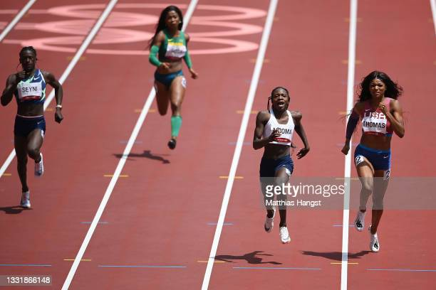 Christine Mboma of Team Namibia and Gabrielle Thomas of Team United States compete in round one of the Women's 200m heats on day ten of the Tokyo...