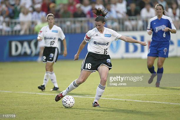Christine McCann of the Boston Breakers dribbles the ball against the Carolina Courage during the WUSA game on July 13 2002 at SAS Stadium in Raleigh...