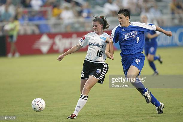 Christine McCann of the Boston Breakers is pressured by Birgit Prinz of the Carolina Courage during the WUSA game on July 13 2002 at SAS Stadium in...