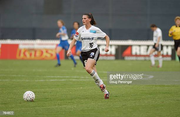 Christine McCann of the Boston Breakers looks to move the ball upfield during the WUSA game against the Washington Freedom on June 12 2002 at RFK...