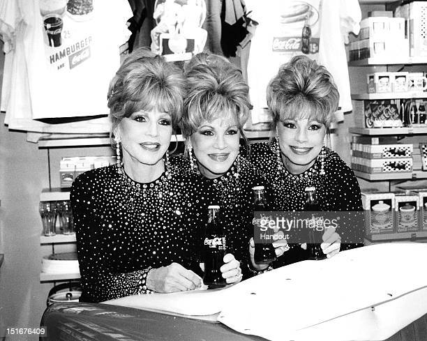 Christine McGuire Phyllis McGuire and Dorothy McGuire of The McGuire Sisters attend the opening of the World of CocaCola on July 7 1997 in Las Vegas...