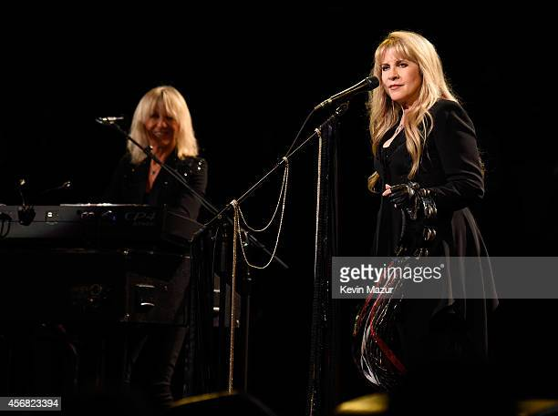 Christine McVie and Stevie Nicks perform at Madison Square Garden on October 7, 2014 in New York City.