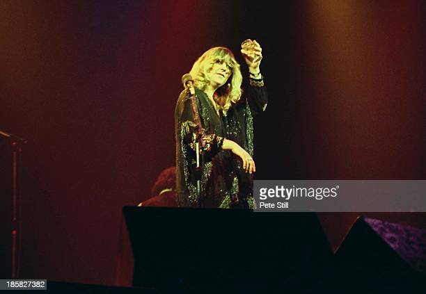 Christine McVie of Fleetwood Mac toasts the audience after the band's performance on stage at the Glasgow Apollo on April 4th 1977 in Glasgow Scotland