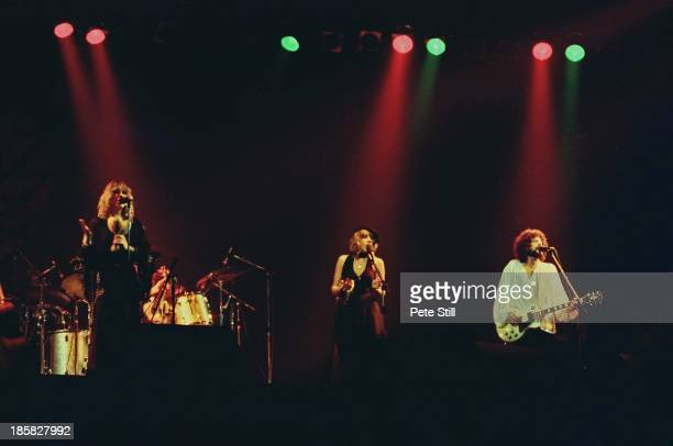 Christine McVie, Stevie Nicks and Lindsey Buckingham of Fleetwood Mac perform on stage at the Glasgow Apollo, on April 4th, 1977 in Glasgow, Scotland.