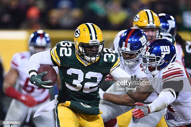 Christine Michael of the Green Bay Packers runs for yards against the New York Giants during the NFC Wild Card game at Lambeau Field on January 8...